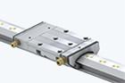 Guidages linéaires avec guidage hydrostatique compact